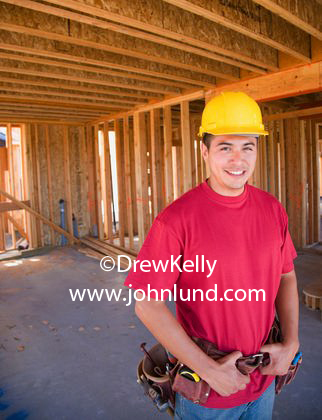 Photo Of A Handsome Hispanic Or Mexican Construction Worker In Hard Hat And On Job Site