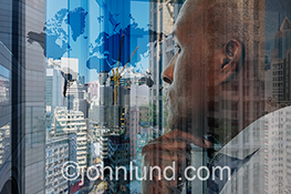 In this stock photo an African American businessman looks out over an urban scene and contemplates important decisions that must be made.
