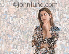 A woman contemplates social media as she appears in varying degrees of opacity and transparency over a background composed of over a hundred individual portraits.
