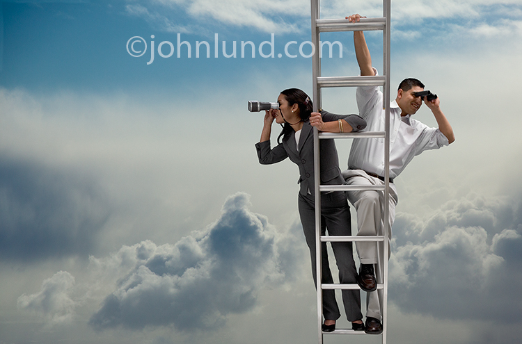 Search the cloud, a man and a woman stand together on a ladder high up in the clouds using binoculars.