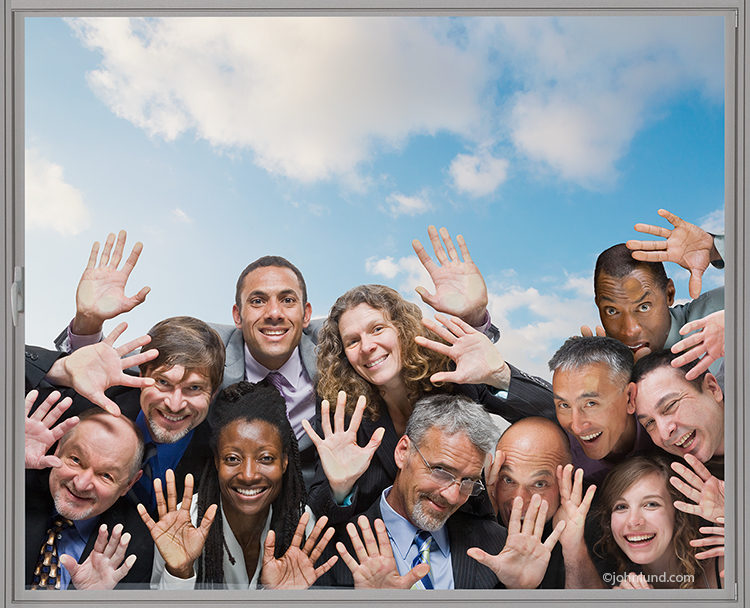 A crowd of people press their faces against the glass of window peering in excitedly in a concept stock photo about popularity, success and ideas.