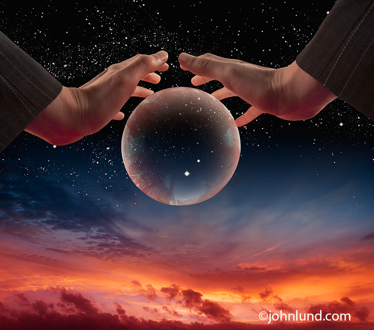A pair of hands float over a crystal ball in a twilight sky in an image that is a metaphor for vision, the way forward and predicting the future.