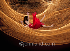 This stock image of a woman falling into a net of light trails is a metaphor for a cyber safety net which can apply from everything from financial security to Internet firewalls.