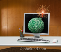 A computer monitor shows a bomb, fuse burning, created out of a circuit board in an image depicting cyber terrorism, hacking, computer viruses, computer worms and computer problems.
