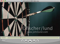 An ultra slow motion video of a dart hitting the bullseye of a dart board in a business, concept stock video