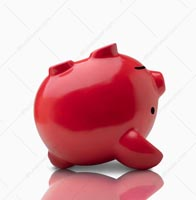 In this piggy bank stock photo the piggy bank is a dead piggy bank laying on it's back and showing failed savings and investments efforts.