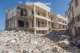 Destroyed buildings and piles of rubble speak of war, earthquakes and other disasters in this dramatic stock photo.