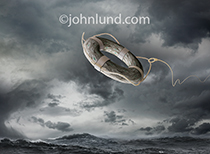 A life ring or life preserver made of money sails out over rough seas in a metaphor for financial assistance.