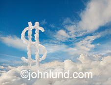 Clouds form a dollar sign to indicate financial and businiess opportunities as well as success available through Internet connections in