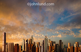 A dramatic sunrise is the background for this futuristic city skyline image that has been created from numerous cities and serves as a generic unspecified metropolis.