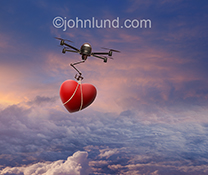 A drone deliveres a valentine heart in this stock photo about love and romance in the digital age.