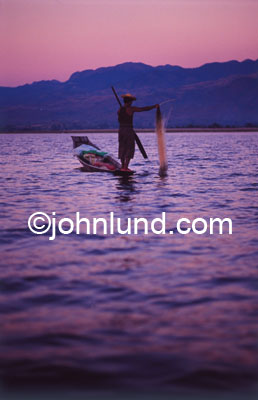 Picture of fishermen in Inle lake, Burma. Inle lake is the setting for this man fishing just after sunset.