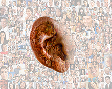 An ear for the cloud, this stock photo has an ear superimposed over a background of social media portraits in an image about listening to and hearing the crowd as well as for big data issues.