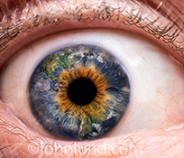 Earth is seen reflected in an extreme close up of a human eye in a stock photo about visions of our planet, environmental awareness, and global thinking.