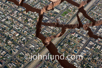 In this earthquake damage photo an aerial perspective shows deep crevices cutting through the neighborhood in a fictional depiction of an earthquake ravaged city.