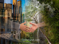 A vibrant metropolis intersects with nature's verdant and lush greenery in an image featuring a symbiotic agreement symbolized by two hands about to clasp in a handshake.