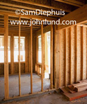 Picture of the framing on the inside of a buidling under construction. New construction interior shots showing naked framing. Photos of the inside of a house being built. No interior walls.