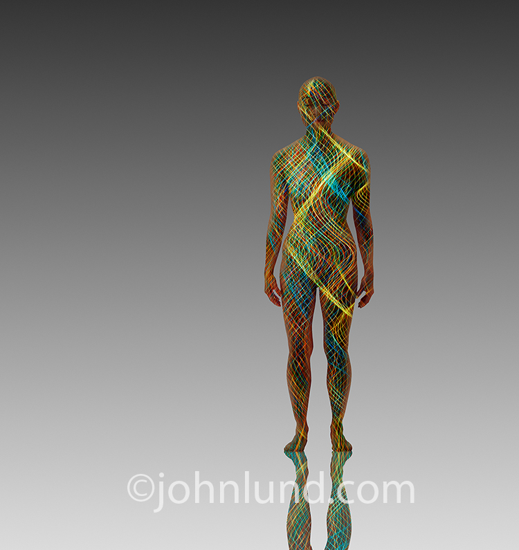 Energy meridians, alternative medicine, and spirituality are illustrated in this stock photo showing a woman filled with colored lines of energy.