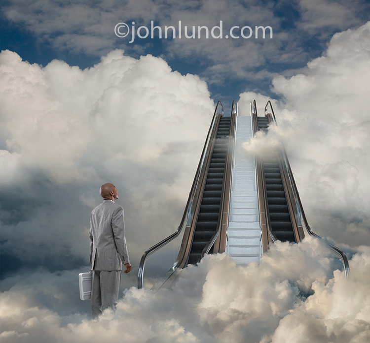 Success, while elusive, is attainable as illustrated in this image of a businessman at the foot of an escalator leading to