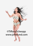Funny foto of an Asian woman wearing underwear made out of money or US currency. Woman has long black hair blowing in the breeze. She is standing on a white background and wearing only a few bucks.