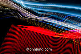 High tech ideas and concepts are expressed in this stock photo of light trails that give a sense of both place and technology as well as speed, energy, and communications.