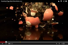 Super Slow motion HD video of a piggy bank exploding in a shower of coins and ceramic chunks and illustrating the risks, dangers, and even rewards of smart investment strategies.