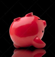 A failed investment or savings program is shown in this stock photo of a piggy bank on it's back.