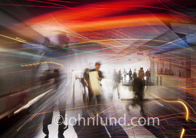 A vibrant, colorful montage of people on the move for business with packages and light streaks indicating speed and communications.