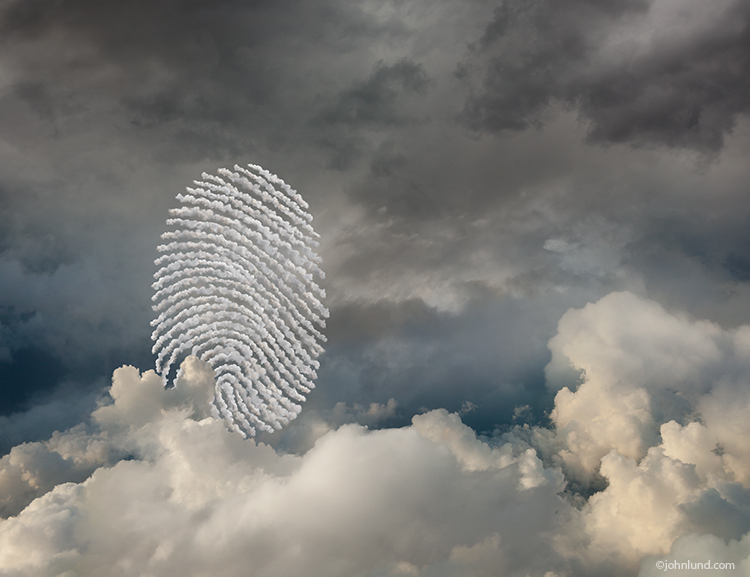 "Within a cloudscape is a formation of smaller clouds forming the unmistakable shape of a fingerprint in a concept photo about security in ""the cloud"" and online."