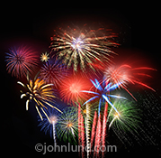A spectacular fireworks display is the subject of this vibrant and colorful fourth of July photograph which combines numerous pyrotechnic explosions in vivid bursts of color celebrating indpendence and freedom.