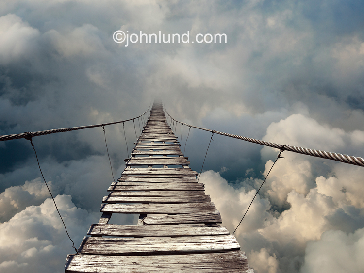 A bridge to nowhere stretches out fading away into a cloudbank in an image of mystery, risk and possibilities.