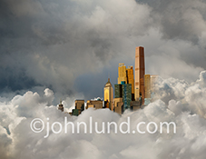 A futuristic city bathed in golden light, rises up from a thick cloud bank in a stock photo about cloud computing, technology, connections and the future.