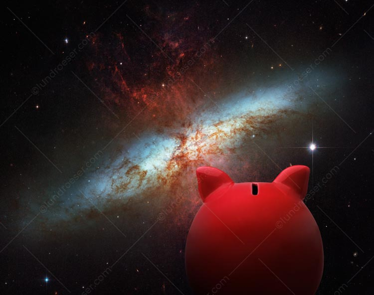 A piggy bank gazes out at a distant galaxy in a stock photo about the investment universe, saving opportunities, and financial exploration.