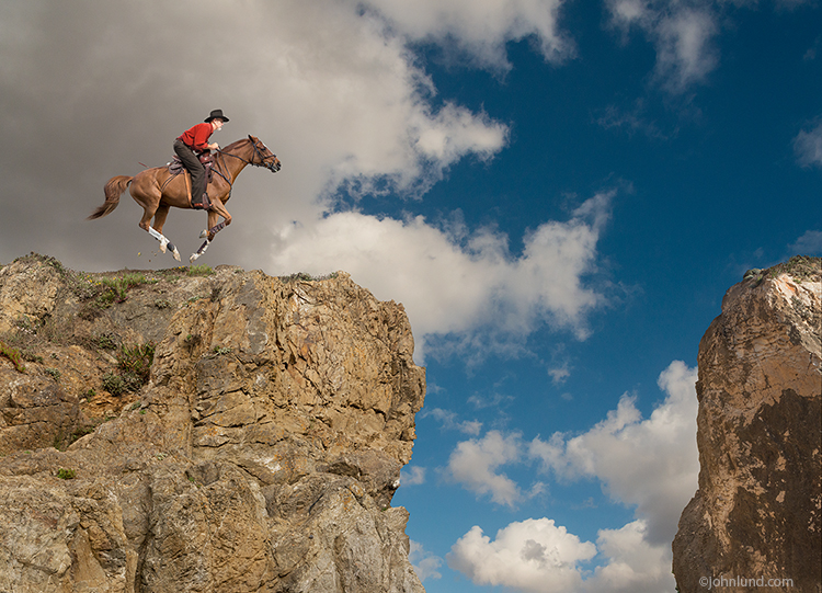 A cowboy gallops his horse towards the edge of a cliff in a concept stock photo about danger, vision, the way forward and danger.