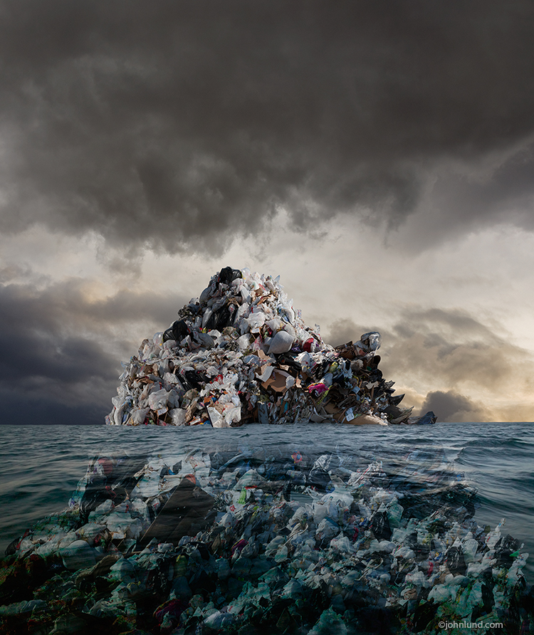 An island of garbage rises up out of the sea forming an island in this photo about pollution, evironmental issues, and the accumulation of plastic waste in our oceans.