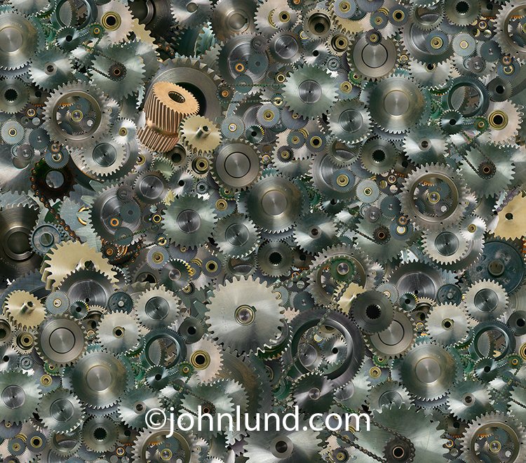 Gears, cogs and sprockets are all compiled into a vast background in a photo that speaks to infrastructure, complexity, working and industry.