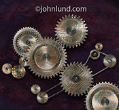 A set of gears are embossed with computer circuitry in this image about technology in the workplace, integrated technology, and technology relationships.