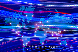 A global map is filled with streaming data and glowing points of light indicating leading business centers through out the world's continents in a stock photo about global commerce and communications.
