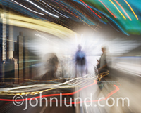 Global business and communications illustrated with a photographic montage of people, cities and colored streaks of light.