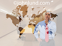 A business executive stands in front of an etched glass world map pondering an important global business decision.