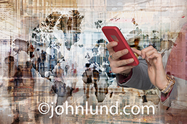 Global commerce and mobile connections are illustrated in this dynamic stock photo of a world map, people in motion, and a woman using her mobile device to stay connected.