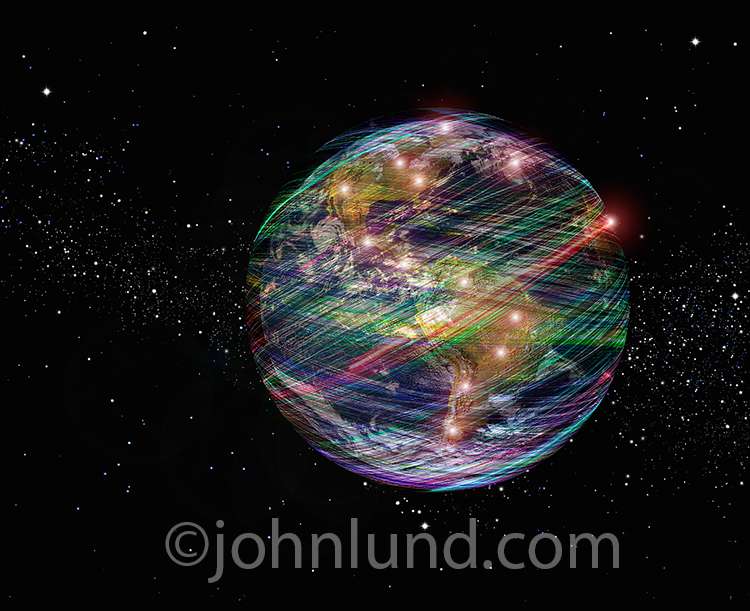 Global communications infrastructure is indicated in this stock photo of the planet earth encased in colored light trails with glowing points of light indicating active communication centers.