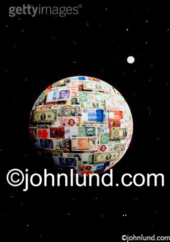 Stock photo of a planet in space made of international money. All kinds of paper money is wrapped around the earth. The moon is visible in the money photo.