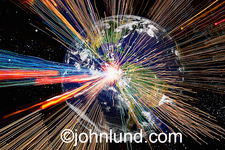 Streaks of colored lights zoom out from the planet earth in a stock photo about global and interstellar communications.