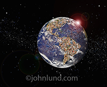 The planet Earth is seen from outer space, and filled with faces across the globe in a stock photo about global population, demographics, ethnic diversity and social media connections.