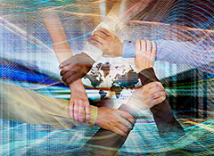 in an image of global teamwork and connection five hands come together in a handclasp over a map of the continents, computer code and streaming data.