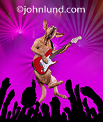 A funny guitar hero dog, a Bloodhound in fact, leaps in the air while playing an electrical guitar on stage in front of a wildly cheering canine crowd thrusting their paws into the air to the beat of the music in this image created for a line of humorous
