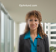 An African American executive woman is half pixelated in a stock photo about the digital workforce, digital assistants and online human resources.