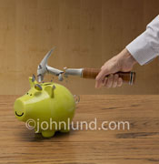 In this photo with a twist, a hammer shatters against a piggy bank indicating secure savings and a smart investment.
