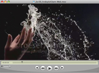A woman's hands toss a splash of water against a black background in a super slow motion stock video clip